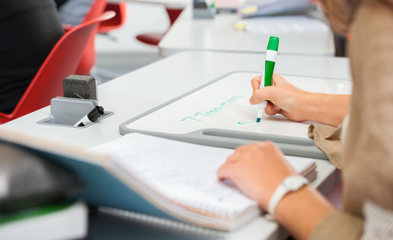 Student using whiteboard